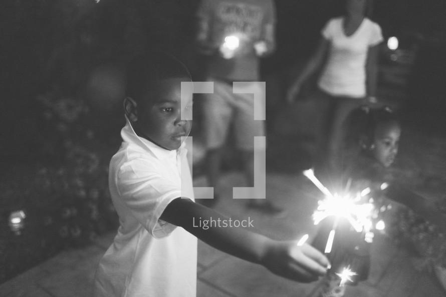 boy holding a sparkler