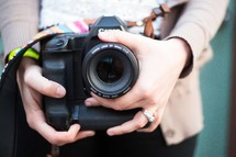 Hands holding a camera.