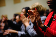 Clapping hands at a worship service.
