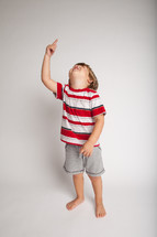 little boy looking and pointing up