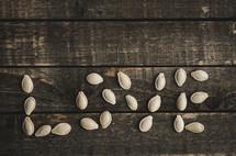 pumpkin seeds on wood, love
