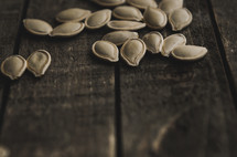pumpkin seeds on wood