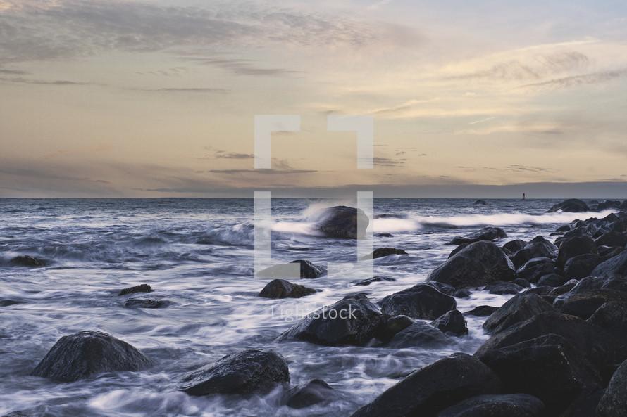 Ocean waves beating against rocks