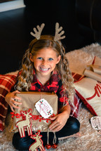 girl child with reindeer antlers