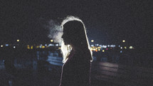 dark, darkness, woman, side profile, standing, outdoors, smoke, night