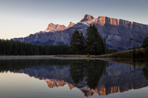 mountain peak across a lake