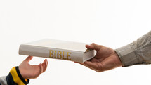Handing off the Bible.