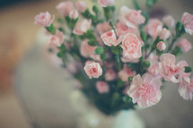 a vase of pink flowers