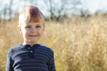 a little boy with a mohawk
