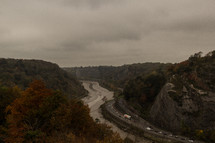 river in a ravine and highway