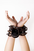 shackled wrists