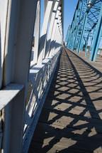 shadows from bridge railings