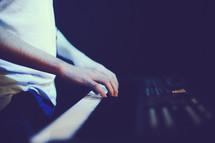hands on a digital keyboard