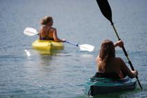 woman paddling canoes