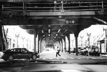 cars driving under an overpass