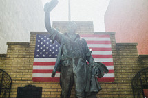 Statue and an American flag