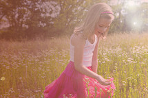 girl child picking wild flowers
