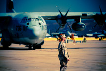 A Serviceman walks the flight line at the Miramar military base.