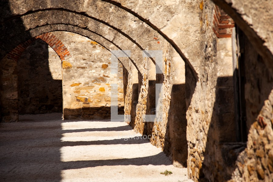 stone archways in the ruins of one of the San Antonio missions