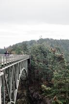 people standing on a bridge