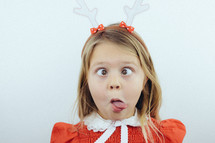 a girl child with reindeer antlers