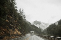 traffic on a wet mountain highway