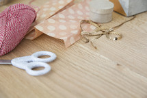 scissors, yarn, ribbon, tissue paper