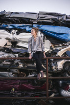 a woman in a scrap metal junk yard
