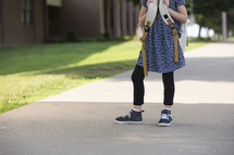 a little girl with a book bag
