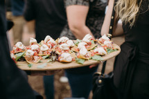 caterer carrying an appetizer tray