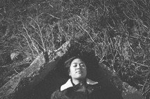 A woman lying on the ground.