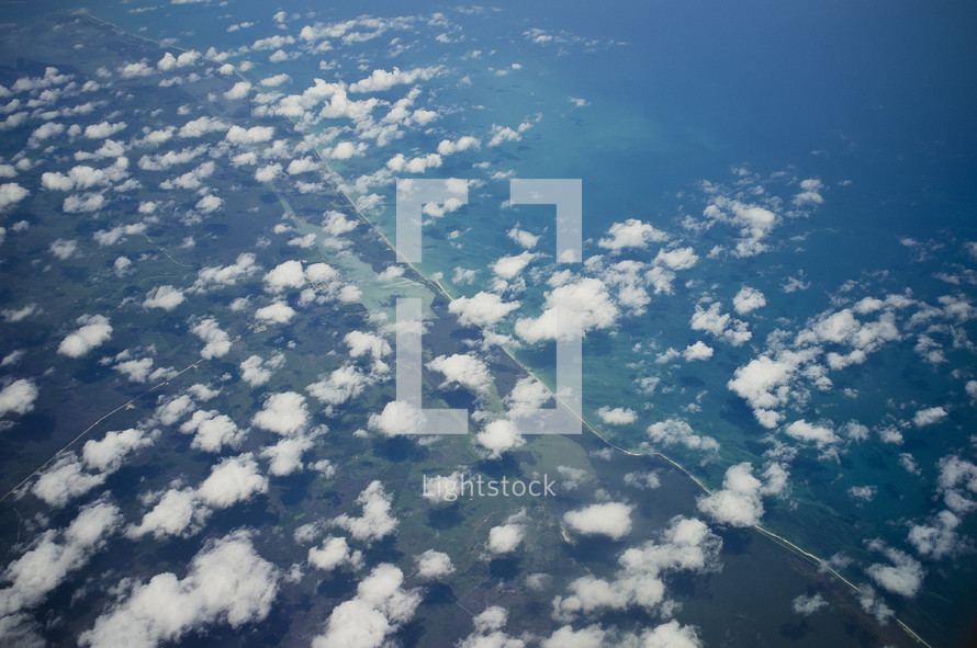 Aerial view of clouds and landscape.
