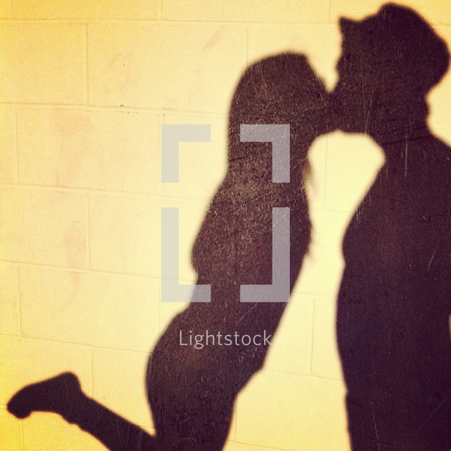 shadow Silhouette of couple kissing