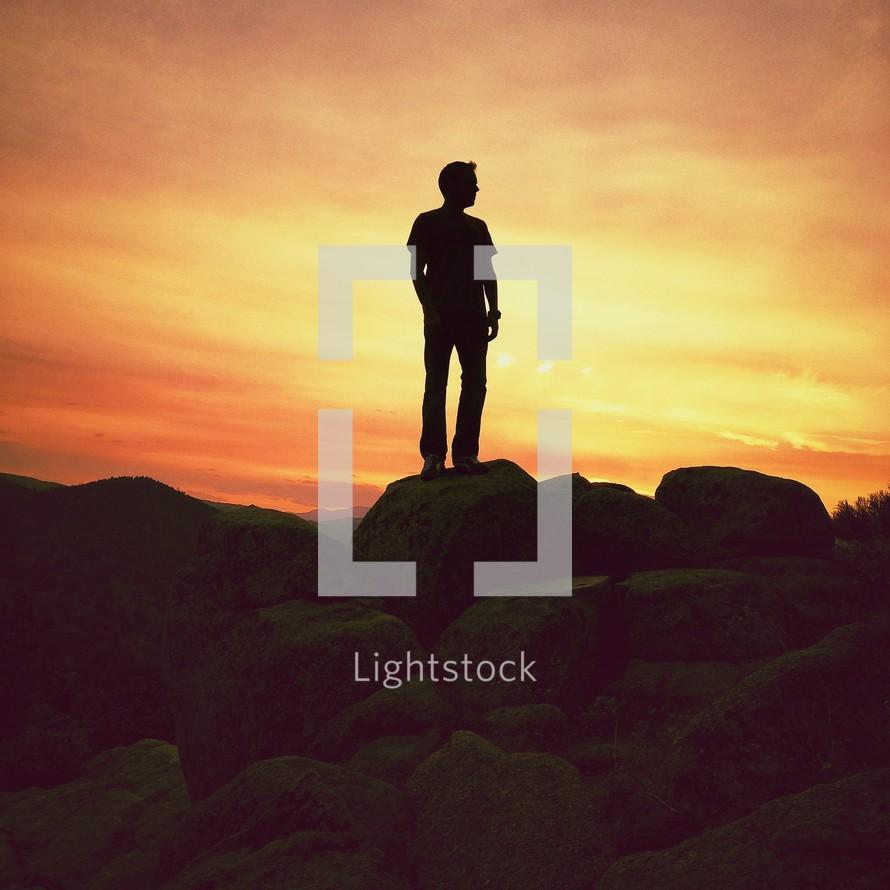 Man standing on large rocks