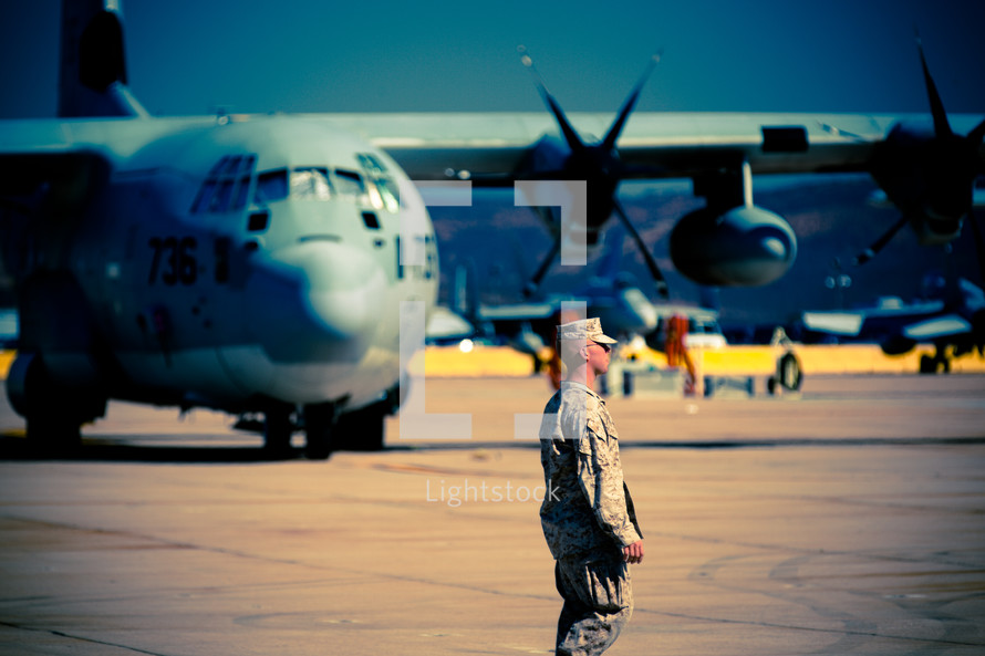 A Serviceman walks the flight line at the Miramar military base.