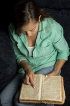 Woman reading old word Bible
