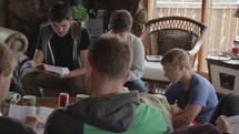 young men and women reading a Bible at a Bible study