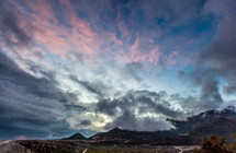 clouds above mountain peaks at sunset