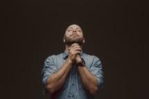 A man in reverent prayer
