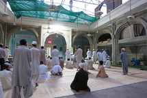 Muslim men in prayer in a mosque
