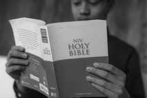 young man reading a Bible