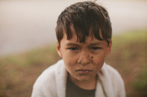 A young boy with a dirty face