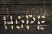 pumpkin seeds on wood, hope