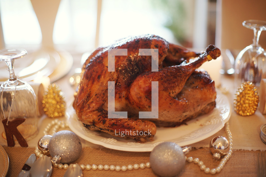 Fresh roasted turkey on a decorated table