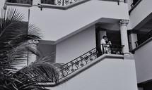 Couple kissing on a balcony