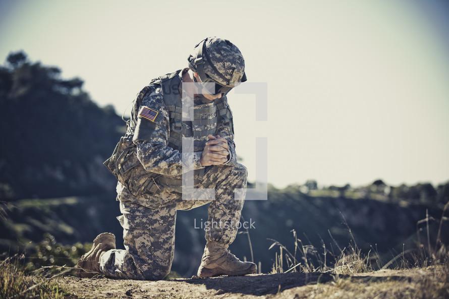 soldier kneeling in prayer