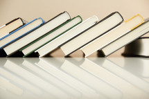 leaning row of books