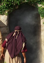 A Disciple of Jesus Christ peers into the empty tomb of Jesus Christ after discovering the stone rolled away and the tomb left open after Jesus was crucified and buried. This beautiful image of hope signifies the resurrection of Jesus. He arose from the dead just as He said He would, overcoming death, hell and the grave .