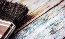 paint brush on weathered wood background