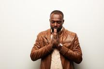 an African American man praying